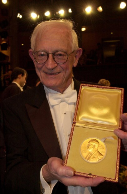 Alan McDiarmid with Nobel Medal