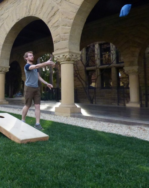On campus at Stanford playing the traditional American backyard game of cornhole